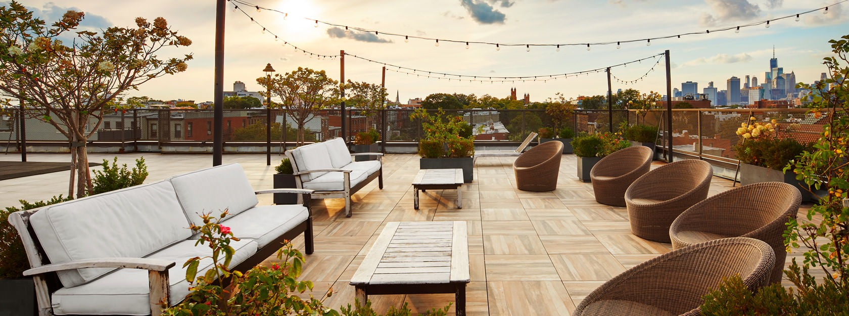 rooftop terrace with stringed lighting and seating areas