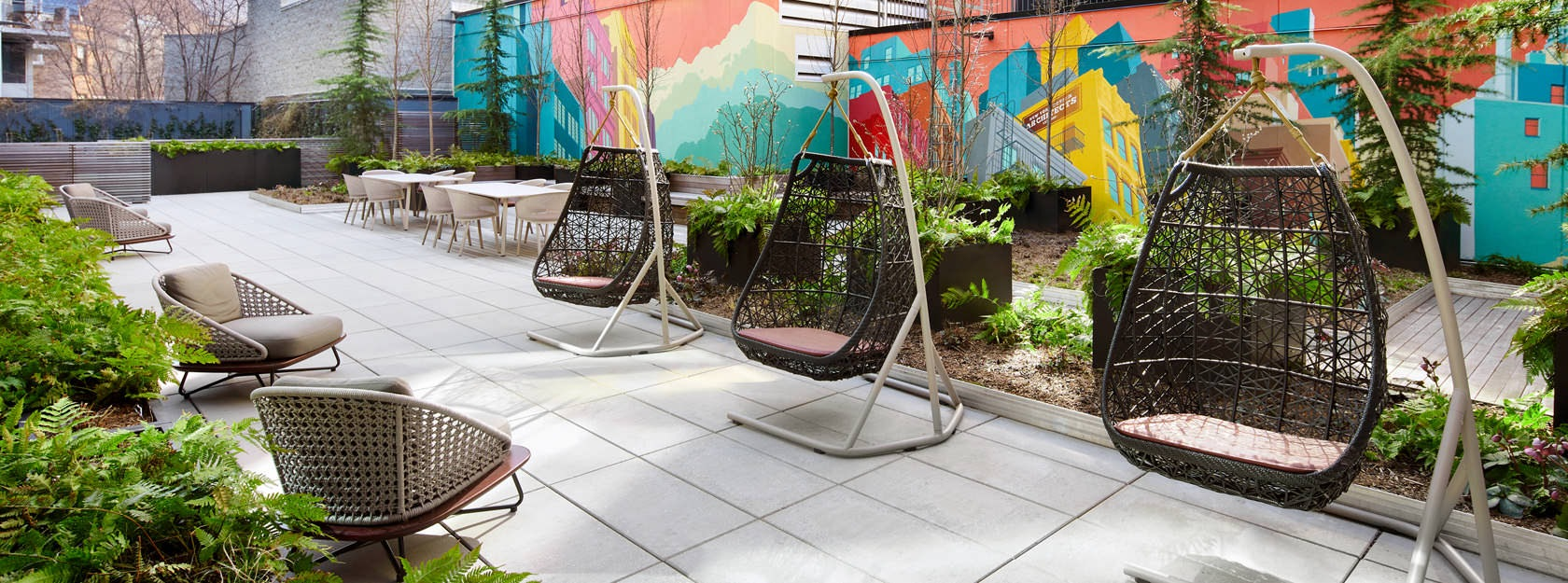 swinging pods and other tables and chairs on patio