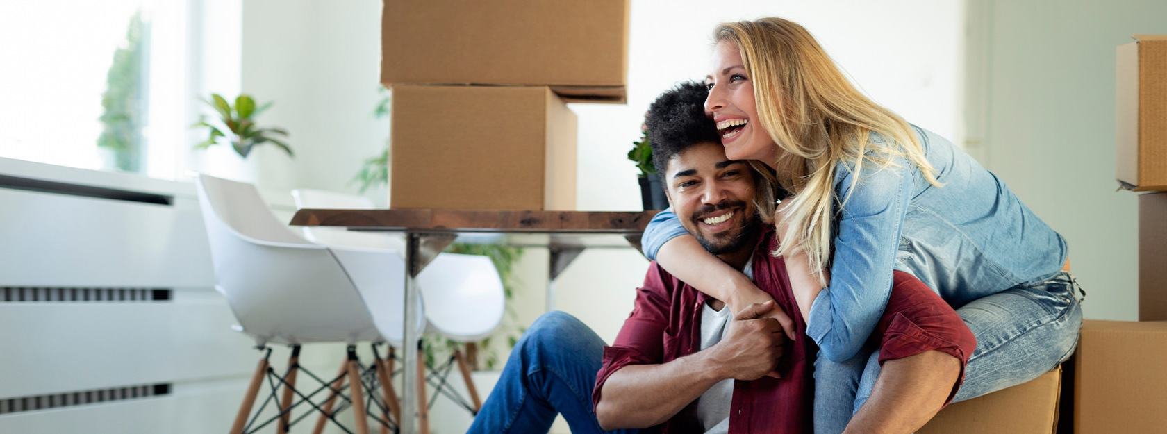 Couple sitting on moving boxes