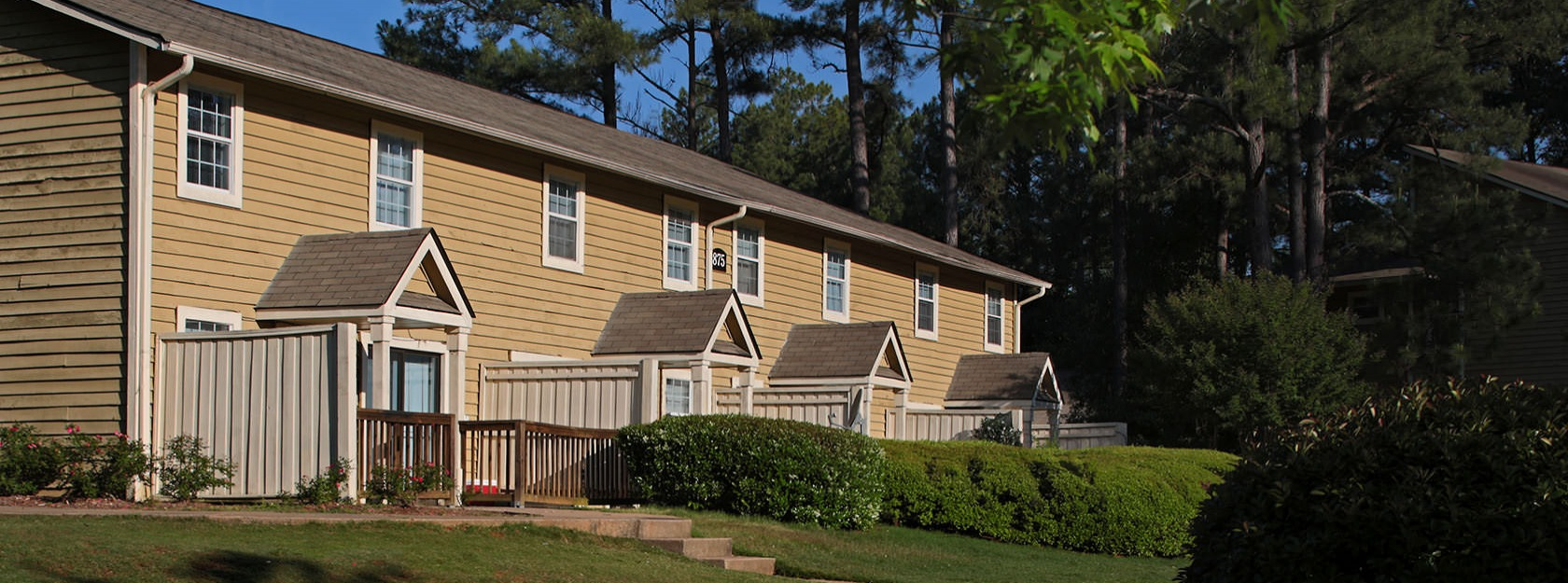 apartments with private, fenced-in yards amid well maintained landscaping