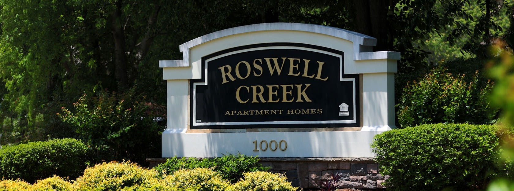 Roswell Creek stone sign at property entrance